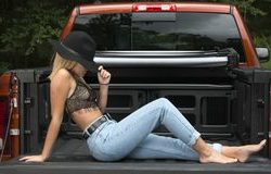 sexy-young-caucasian-woman-poses-back-pick-up-truck-pulling-hat-down-profile-country-girl-beautiful-caucasian-woman-108195620