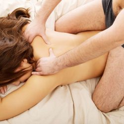 massage_couple_man_woman_laying_dow_cropped-1